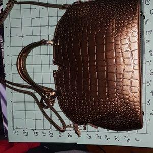 Like new medium size bronze purse